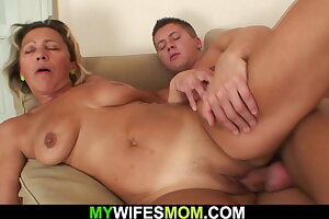 Horny dude fucks sexy mother in law on the couch